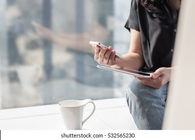 Digital lifestyle blog writer or business person using smart device working online using internet mobile banking communication technology