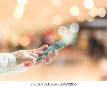 Digital lifestyle business person or shopper using mobile smart phone for retail shopping in mall and supermarket for Black Friday and Cyber Monday shopping concept