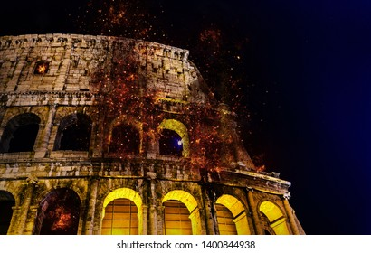 Digital manipulation of fire at the Colosseum or Coliseum at night, Rome, Italy.