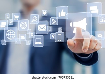 Digital marketing concept with business person touching advertising campaign strategy interface with email, social media, mobile, internet and ROI analytics icons
