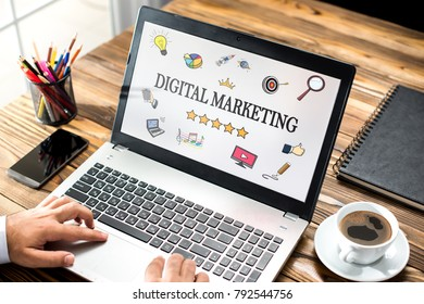 Digital Marketing Concept With Various Hand Drawn Doodle Icons On Laptop Monitor
