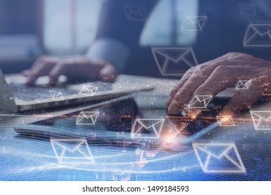 Digital marketing, Email campaign, newsletter, direct sales business strategy concept. Double exposure of business man sending email via digital tablet, laptop computer and smart city with e-mail icon