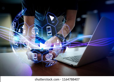 Digital marketing media (website ad, email, social network, SEO, video, mobile app) in virtual globe shape diagram.Waves of blue light and businessman using on smartphone as concept