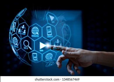 Digital marketing media (website ad, email, social network, SEO, video, mobile app) in virtual globe shape diagram.businessman hand  working with touch screen in action