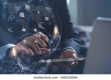 Digital marketing media (website ad, email, social network, SEO, video, mobile app), business strategy analysis concept with modern web icon. Man working on digital tablet in modern office, copy space