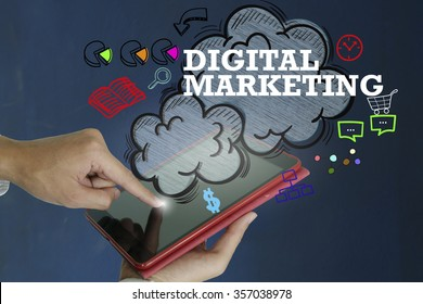DIGITAL MARKETING over a tablet computer on dark blue background , business concept ,business idea