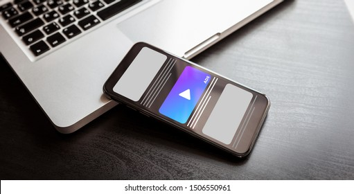 Digital Marketing strategy on digital mobile platform - cross-device tracking programmatic advertising and multi targeting with laptop and mobile phone gadgets on dark wood table