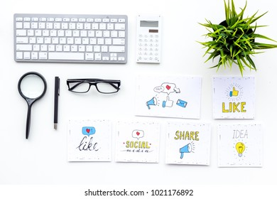 Digital marketing. Work desk of marketing specialist with social media icons and symbols on white background top view