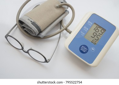Digital Measuring blood pressure , Measuring heart rate show Hypertension or High Blood Pressure and glasses. white background.