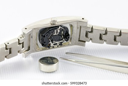 digital mechanism of an analogue  wristwatch with coin cell and tweezer