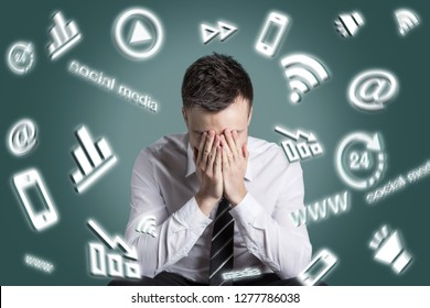 Digital media symbols swirling around an exhausted man
