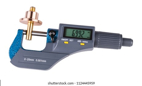 Digital micrometer and shiny metal workpiece. Close-up of measuring a bronze and brass metallic part by the precise gauging device with a green display. Isolated on white background.