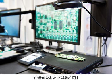 Digital microscopes with monitors from a quality control laboratory