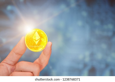 Digital Money and Bitcoine Concept, Bitcoin in the hands, Gold coins are used instead of trading in the digital world.