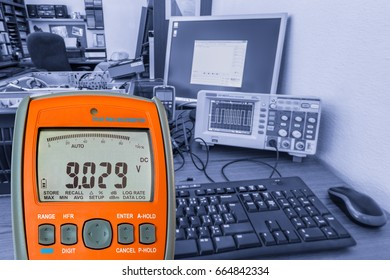 Digital multimeter at the electromechanical workplace