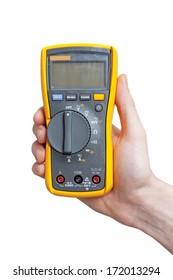Digital multimeter in technician's hand