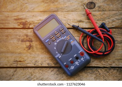 digital multimeter and wiring on wooden table. special tools of technician for work with circuit and electrical. technician use the digital multimeter in workshop for check and repair equipment.