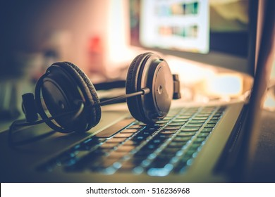 Digital Music Creation Theme with Professional Headphones on the Computer Keyboard.