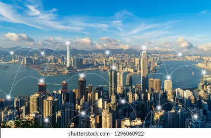 Digital network connection lines of Hong Kong Downtown. Financial district and business centers in smart city in technology concept. Skyscraper and high-rise buildings. Aerial view