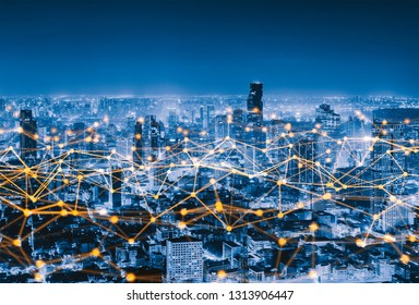 Digital network connection lines of Sathorn, Bangkok Downtown, Thailand. Financial district and business centers in smart urban city in Asia. Skyscraper and high-rise buildings at night.