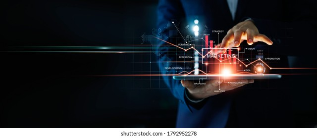 Digital online marketing, Businessman using tablet and analysis sale data graph growth on modern interface icons on strategy, Solution analysis and development contents on global network connection. - Shutterstock ID 1792952278