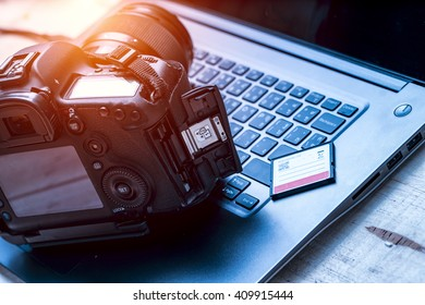 Digital Photography Workstation. Modern Digital DSLR Camera, Laptop Computer and Display.