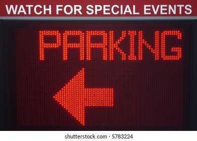 "A digital pixelboard parking sign with a left pointing arrow.  Sign has a ""Watch for Special Events"" header."