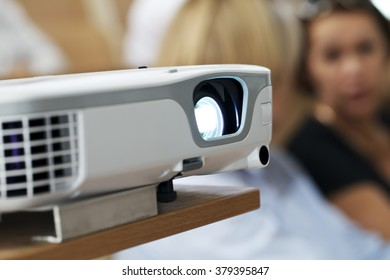 digital projector at the presentation close-up on the foreground, blurred background