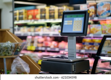 Digital scales with screen for product weighting in modern supermarket