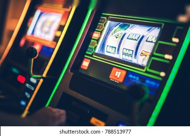 Digital Slot Machines Playing. Casino Gambling Concept Photo.