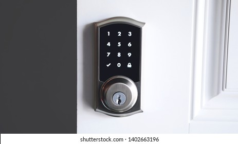 Digital smart door lock security system with the password, close up on numbers on the screen. - Shutterstock ID 1402663196
