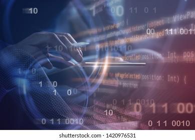 Digital software technology development concept. Man programmer, software developer coding on digital tablet computer with binary, computer code and big data on virtual screen