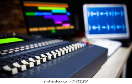 digital sound mixer in recording studio, shallow dept of field. music background