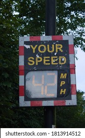 Digital speed limit sign, displaying 42 MPH. Driver can see in display his Speed and a Smiley under limit or a sad face by driving too fast