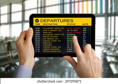 Digital tablet in airport with flight schedule and departure and gate information