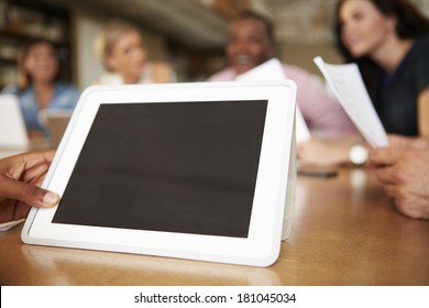 Digital Tablet Being Used By Architect In Meeting