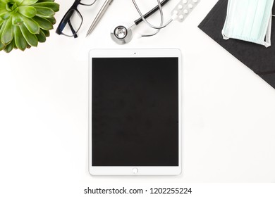 Digital Tablet With Blank Screen And Medical Equipment On Table