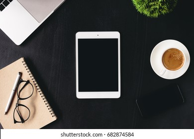 digital tablet blank screen on work desk top view
