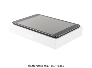 Digital tablet with its box on white background. Isolated.