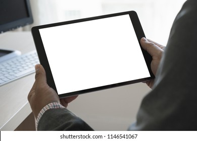 Digital tablet computer close up man using tablet hands man multitasking with isolated screen