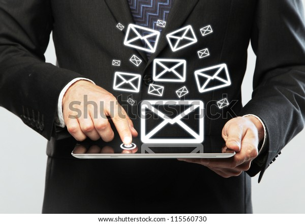 digital tablet in hand and email icon