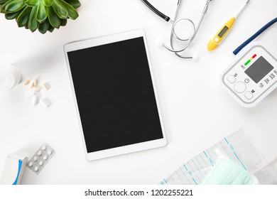 Digital Tablet And Medical Instruments On Table