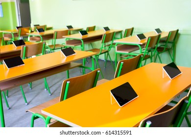 Digital tablet on the desk in classroom