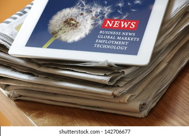 Digital tablet on newspaper concept for internet and electronic news