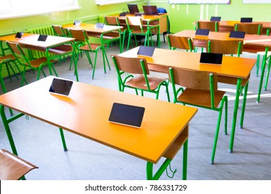 digital tablet on table in classroom at school