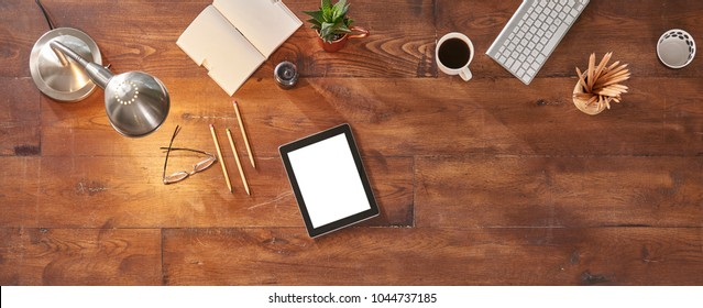 digital tablet on the table and technological term detail isolated for advertisement screen with lamp concept