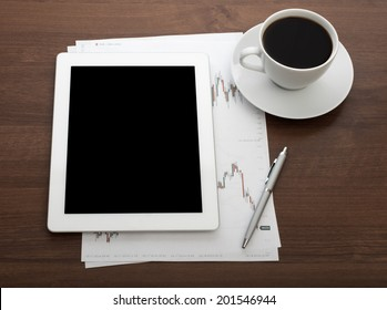 Digital tablet on wooden tablets with mobile and coffee