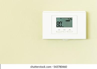 Digital Thermostat set to 80 degrees Fahrenheit regulate temperature.