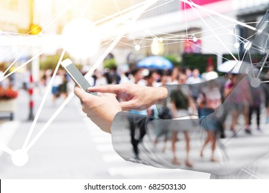 Digital transformation of internet of things technology disruption , big data ,online shopping concept. Neural networks connect atoms , business man using smart phone and blur city people cross road.