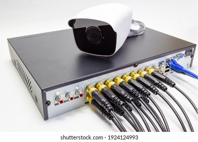 Digital Video Recorder and video surveillance cameras on white background